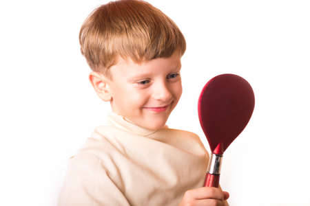 barber scissors: boy cuts the barber girl with scissors in hand Stock Photo