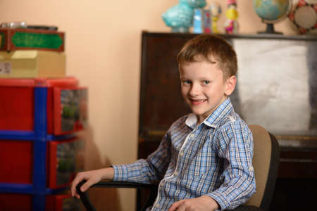 Young man in an office chair. Different facial expressions and emotional moods. Stock Photo
