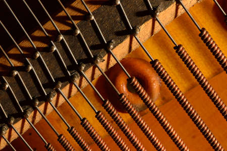 Piano strings sound tuning music. The tuner of a musical instrument. Stock Photo