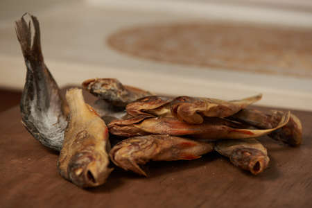 Still life. Dried sun dried fish. River perch. Salty delicious fragrant.  Stock Photo