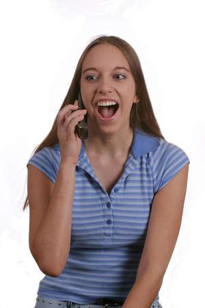 Teen girl talking and laughing on phone. Фото со стока
