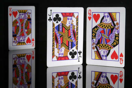 You know the story, Oedipus loved his mother and killed his father. Jack of spades and queen and king of hearts on black plexiglass.