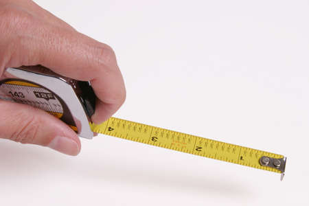 Maßband in die Hand von links Standard-Bild - 271501