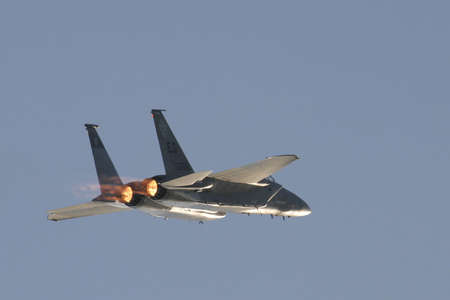 afterburner: F-15 in flight with afterburner flames visible