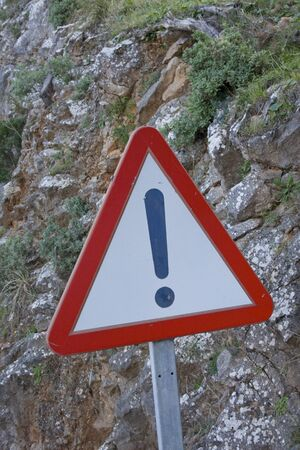 Caution sign on dangerous road Stock Photo - 13594720