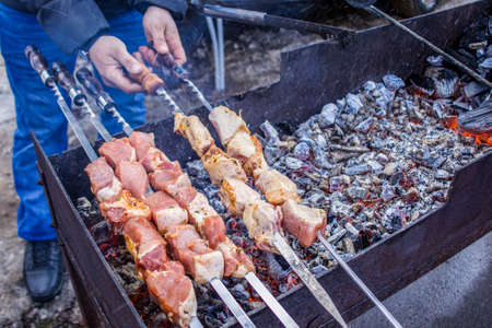 Skewers on skewers are fried over an open fire. 写真素材