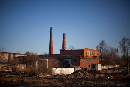 Brick factory of the old architectural style. Boiler pipes.