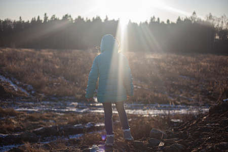 A child at a clearing. Environmental protection by children. 写真素材