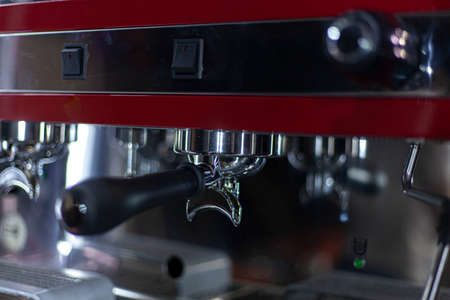 Coffee machine inside the car. Professional car preparation for the coffee trade. Store on wheels. Coffee grinder and milk fryer. The new coffee machine is conveniently integrated into vehicles. Stock Photo