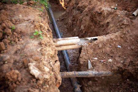 Gas pipes in the ground. Laying communications. Creation of a heating main. Construction works. Providing home utilities. Excavation for repair of communications.