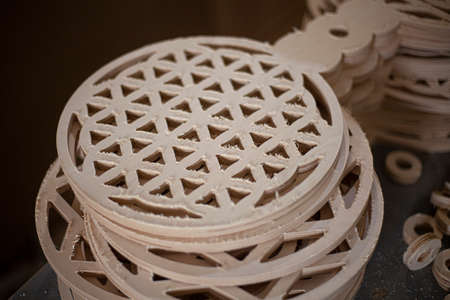 Fractal made of wood. Blank for painting. Geometric pattern whitewashed in round plywood. A model for a mandala coloring class. Made in a wood workshop.