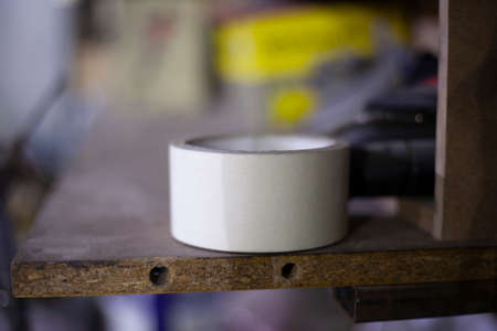 Adhesive tape for fixing items. Adhesive tape. Subject in the workshop. A simple thing everyone needs in the house.
