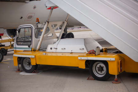 Special vehicles on the runway. Loader at the airport. A special machine for moving an airplane. Security at the airport is ensured by appliances.