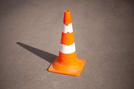 The cap is orange. Road sign fencing path. Means for warning people about an obstacle on the highway.