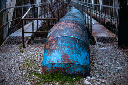 WGas pipe. Old pipe for industrial use. City communications to supply the city with gas. Peeling paint. Stok Fotoğraf