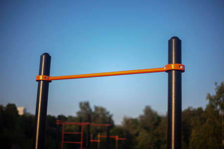 Pull-up bar. Sports equipment on the street. Sports equipment in the playground.