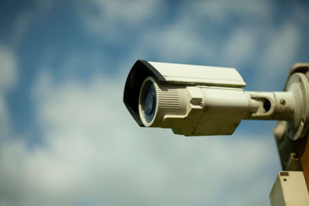 Video surveillance camera. Security system of the territory. Surveillance camera on the street. Recording of an event occurring around