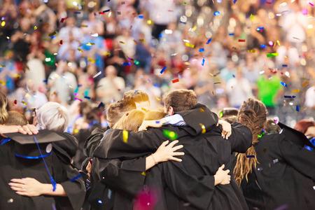 Students celebrating graduation day, authentic photo 写真素材