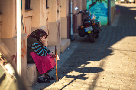 Beggar sitting at the corner of the street