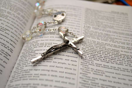 crucifixes: Rosary Beads on an Open Bible