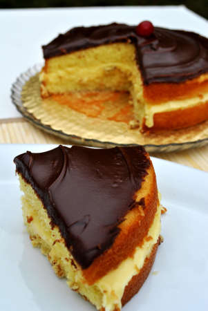 A slice of Boston cream pie cake served