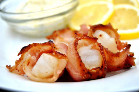 Bacon wrapped scallops with tarter sauce and lemon