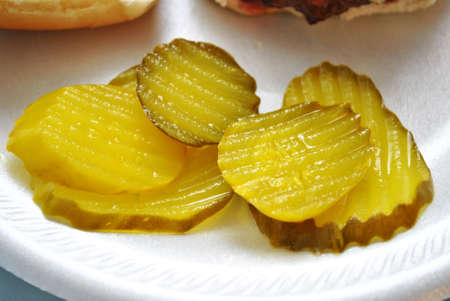 Sliced pickles on a plate