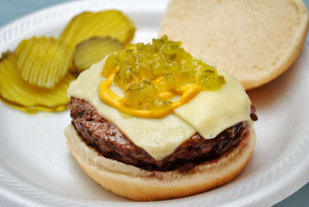 Cheeseburger with relish, pickles and mustard