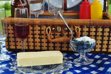 Picnic Basket with Wine, Cheese, and a Blueberry Dessert photo