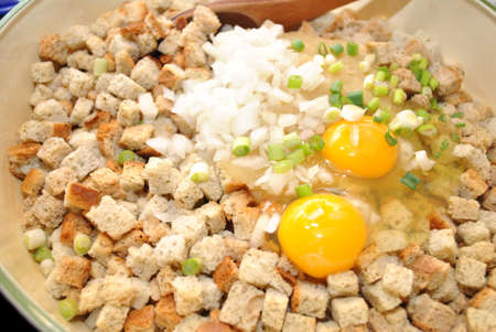 stuffing: Preparing Bread Stuffing with Eggs and Onion Stock Photo