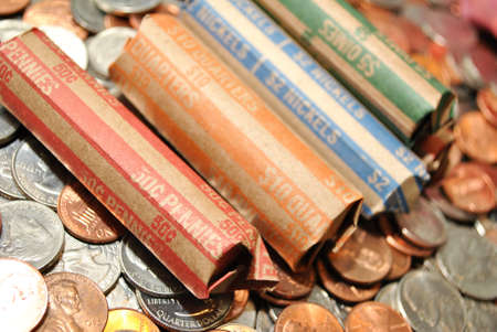 coinage: Bank Rolled Coins Over Loose American Coinage