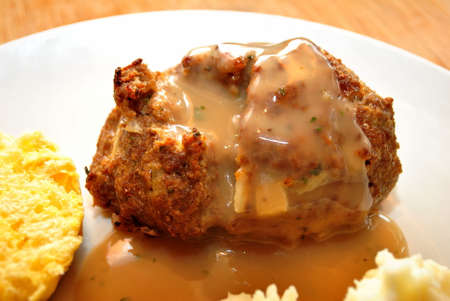 meat loaf: Mini Meat Loaf with GravyServed on a Plate Stock Photo