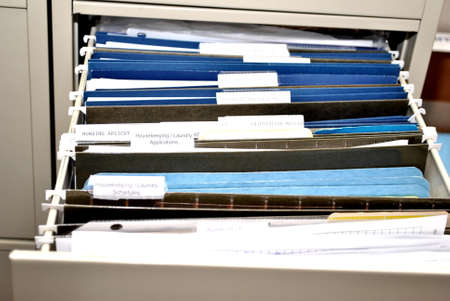 overflows: Open File Drawer with Blue Files