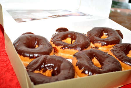 6 Pack of Donuts Chocolate Glazed Doughnuts Stock Photo