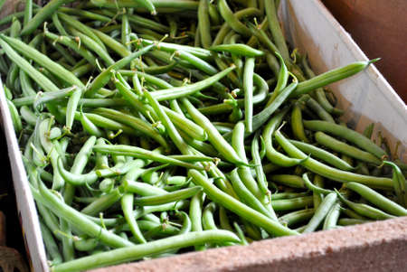 long bean: Fresh Green Beans in a Box at the Farmers Market Stock Photo