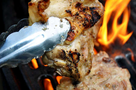protien: Flaming Chicken Thigh on the Grill Stock Photo