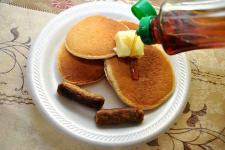 Pouring Syrup on Hot Pancakes Stock Photo - 25390459