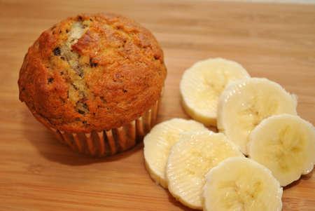 Fresh Banana Nut Muffin with Sliced Bananas Stock Photo
