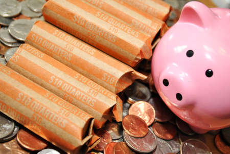 Quarters on Coins with a Pink Piggy Bank photo