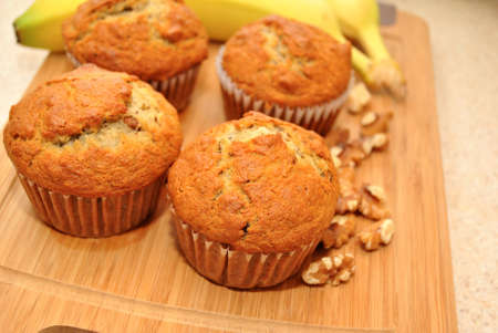 Fresh Muffins with Ingredients on a Cutting Board