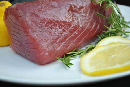 fishy: Fresh Tuna On A Plate With Lemons