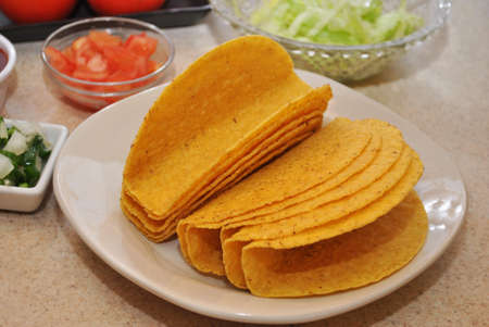 Taco Shells on a Plate with Some Ingredients photo