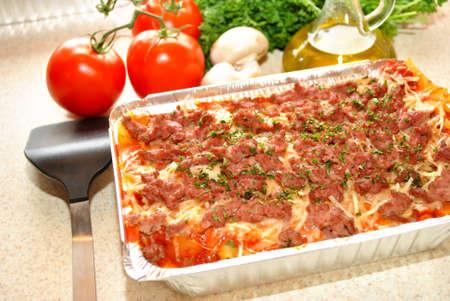 Fresh Ingredients Behind a Pan of Lasagna Reklamní fotografie