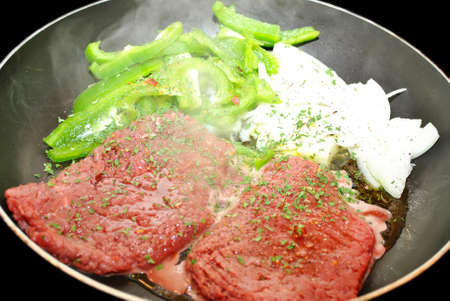 steamy: Steamy Cube Steaks, Peppers and Onions in a Fry Pan