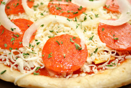 hotter: Close-Up of a Raw Pepperoni Pizza with Onions Stock Photo