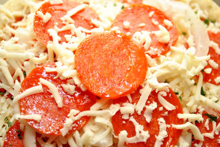 Extreme Close-Up of Raw Pepperoni Pizza photo