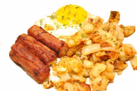 Delicious Breakfast of Potatoes, Eggs and Sausage Links photo