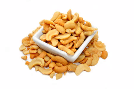 Halved Cashews in a Square White Bowl photo