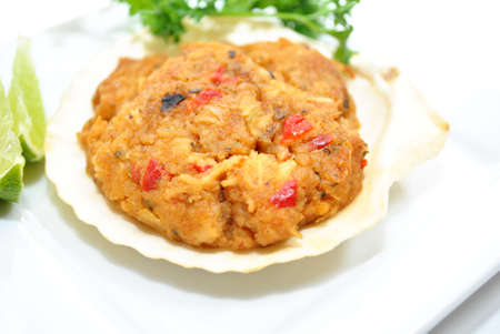appetiser: Appetiser of Crabmeat Stuffed Scallop Shell Stock Photo
