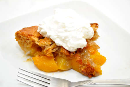 doughy: Serving of Peach Cobbler on a White Plate